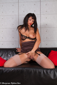 Hot MILF Spreads Her Legs On A Black Couch 05