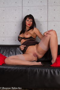 Hot MILF Spreads Her Legs On A Black Couch 06