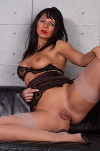 Hot MILF Spreads Her Legs On A Black Couch 07
