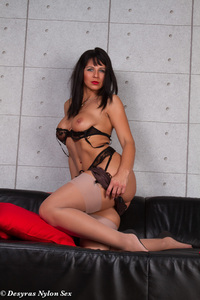 Hot MILF Spreads Her Legs On A Black Couch 09
