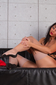 Hot MILF Spreads Her Legs On A Black Couch 11