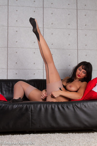 Hot MILF Spreads Her Legs On A Black Couch 12