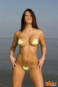 Brunette Babe Posing In Tiny Hot Bikini 00