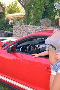 Lucy Li Posing With Red Car And Huge Boobs  00