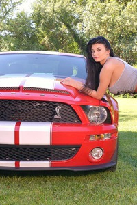 Lucy Li Posing With Red Car And Huge Boobs  04