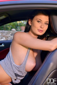Lucy Li Posing With Red Car And Huge Boobs  17