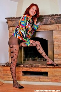 Redhead Babe Posing In Pantyhose By The Fireplace 01