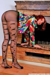 Redhead Babe Posing In Pantyhose By The Fireplace 02