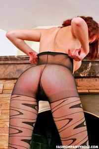 Redhead Babe Posing In Pantyhose By The Fireplace 14
