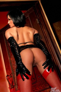 Tory Lane Getting Naughty In Her Shiny Dominatrix Wear 11
