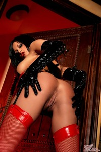 Tory Lane Getting Naughty In Her Shiny Dominatrix Wear 12
