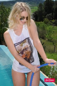 Jess Davies Cools Herself Off By The Pool 11