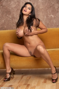 Sunny Leone Lounging On The Couch 06