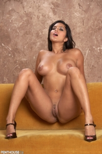 Sunny Leone Lounging On The Couch 09
