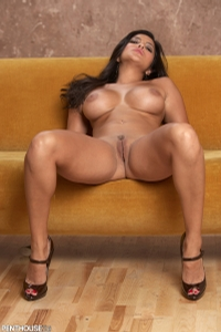 Sunny Leone Lounging On The Couch 11