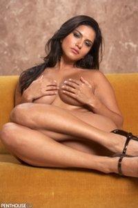 Sunny Leone Lounging On The Couch 12