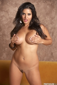Sunny Leone Lounging On The Couch 13