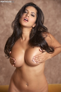 Sunny Leone Lounging On The Couch 14
