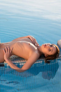 Martina Gets Nude By The Pool 19