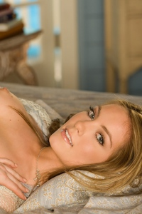Holly Jo Strips On A Bed 11
