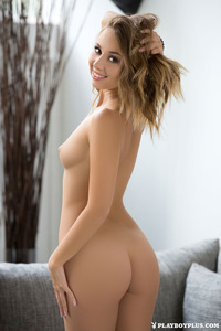 Linda Poses Nude On A Couch 11