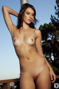Slender Brunette Cybergirl Sophia Beretta Strips Nude 12