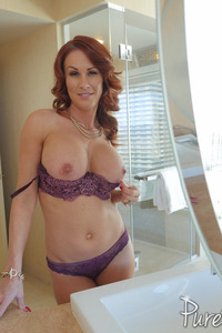 Busty Redhead MILF Sabrina Cyns Strips In The Bathroom 05