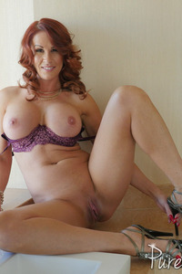 Busty Redhead MILF Sabrina Cyns Strips In The Bathroom 09