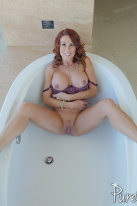 Busty Redhead MILF Sabrina Cyns Strips In The Bathroom 13