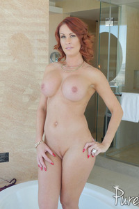 Busty Redhead MILF Sabrina Cyns Strips In The Bathroom 16