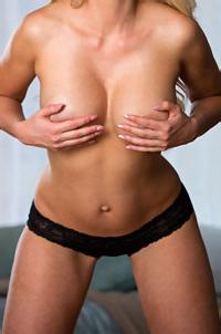 Gigi Allens Peels Off Her Black Top