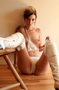 Tattooed Brunette Strips
